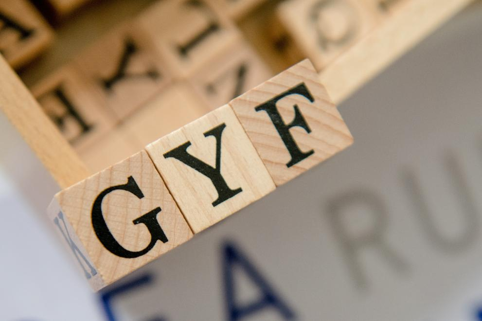 Letter Cubes spelling the abbreviation GYF